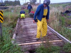 Volunteers repairing a bridge.