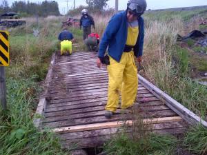 Volunteers repairing a bridge.